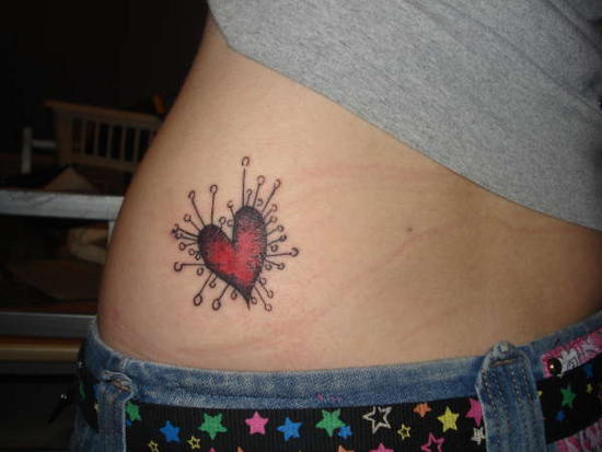 red tattoos. Yet another red heart tat,