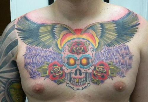 Athour taTToo: skull and wing tattoo