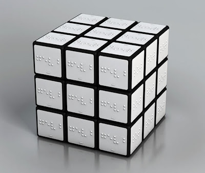 white rubik's cube with braille labels