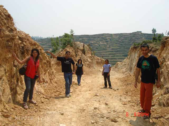 Memorable Trip to mukteshwar with office friends... : Posted by VJ SHARMA @ www.travellingcamera.com : In 2008, we planned this wonderful trip to Mukteshwar in Uttrakhand ... We had a decent group of 6 friends who hired a cab for this lovely hills stations in calmness of Uttrakhand... It was a well spent and enjoyable trip on one of the weekends... Here are few photogrpahs of this trip with brief details...VJ doing rappelling @Chauli ki Jali, Mukteshwar, Uttrakhand... There are different adventurous sports available in Uttrakhand hills and we enjoyed some of them in Mukteshwar...Gang lost in Forests around Mukteshwar... After checking in to the resort @ Mukteshwar on Saturday Morning, we planned to go out for Jungle trip (Don't remember the name of that forest...) We drove down to a place near main Mukteshwar Market and headed down towards a dense Jungle... Some of us were very adventurous to hike trees, try various routes, climb steep hills n all :) and some of us were trying to advise them for avoiding all that... overall it was great fun and we came back from a very dense part of the forest and on back route we forgot the path we had followed to enter into the forest...Here is the gang except Ram who clicked this photograph... Road construction was going on for a village which was on the other side of this forest...A very long tree without leaves in the courtyard of Mukteshwar Temple... It was a very calm place on hill-top which was just behind Chauli-ki-Jali... All the girls sat there on different corners to spend some time in complete silence... Although boys were not talking but they were waiting for girls to get up and move towards our cab... They spent about 30 minutes in complete silence and they enjoyed it, as they described...Here is the resort where we stayed at Mukteshwar.. I think the name was Krishna Resort, it's a decent place to stay in Mukteshwar with nice food...It was fun fulled stay at the report with bone fire in the evening, TT, nice place to roam around n what not....Here is the brave girl Vaishali who dared to initiate for Rock Climbing at one of the dangerous place... there was a steep valley below this rock and it was hard to see the bottom part of the valley... Vaishali started climbing and everyone enrolled for it...Wooden Temple @ Mukteshwar in Hilly State Uttrakhand in INDIA...Again frontal view of the resort where we stayed... Next morning we went for morning walk, at least four of us...n walked through beautiful hills on roadside... We invented some new games and it will be difficult for me to explain those games here...  But I can share names :