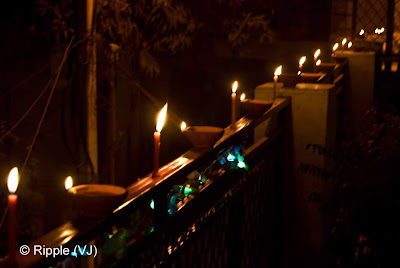 Posted by Ripple (VJ) : Diwali Celebrations 2008 (Indian Festivals of Lights): A row of Candles and Clay Diyas on Diwali Day: From opposite Side