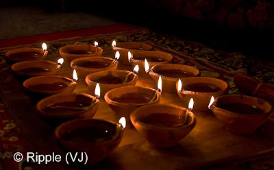 Posted by Ripple (VJ) : Diwali Celebrations 2008 (Indian Festivals of Lights): Clay Diyas during Laxmi Pooja from different angle