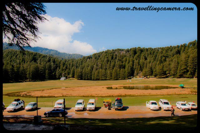 HPPWD Guest House @ Mini Switzerland of Himachal Pradesh, INDIA : Posted by VJ Sharma @ www.travellingcamera.com : Khajjiar in Chamba District of Himachal Pradesh is known as mini Switzerland of India. Its a beautiful place between Deodar Forests.. A lake on hill top with a splendid view of snow capped hills looks amazing... Khajjiar is just 25 kilometers from Dalhousie and one must go here if planned for Dalhousie or Chamba...A view of Khajjiar Lake from HPPWD Guest House.... For more details about Khajjiar, check out http://hpchamba.nic.in/destkhajjiar.htm Another photograph of Mini Switzerland from HPPWD guest house...HPPWD Guest House @ Khajjiar, Chamba, Himachal Pradesh...Its situated on one edge of Khajjiar Lake and gives amazing view of lake... All the photographs of Khajjiar lake shared in this post have been clicked form this guest House...CLICK on below mentioned links to see more photographs of Dalhousie region in Himachal Pradesh.... Click Here to see snowfall photographs in Dalhousie: My first Rendevous with SnowClick Here to see colorful birds @ Dalhousie ChurchClick here to feel Dalhousie An inetersting and one of the best Hill stations in Himachal PradeshClick here to see Photographs of Mesmerizing Khajjiar Click Here to see beautiful Ravi River near Dalhousie @ Chamba, Himachal Pradesh Click Here to see photographs of Colorful ChambaClick here to see Snow-Covered Peaks of Peer-Panjal Range @ Himachal PradeshClick Here to see Sunset @ Dalhousie, Himachal Pradesh