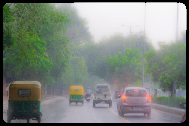 Monsoons in Capital of INDIA ( DELHI ): Posted by VJ Sharma on www.travellingcamera.com : Now monsoon is there in Delhi and probability of traffic jams has increased in capital city of INDIA. Here are few photographs clicked during monsoon season of 2010...As per my definition, Monsoon is a much awaited season after scorching summers and people get bored of this season soon :-)I enjoy rains at times but these should not be continuous... Rains bring freshness in our surroundings but they can ruin many other things due to this continuous behavior... Two senior people struggling with heavy rains and fog of Delhi to reach office in morning @ 10:30 AM... A scene of dense fog near Lodhi estate near India Islamic Center...A scene of dense fog near Lodhi estate near India Islamic Center...Flyover work going on for Common Wealth games in INDIA this year (2010)