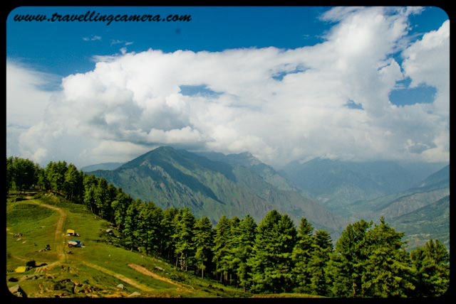 Wonderful trekking experience of Bijli Mahadev @ Kullu-Manali, Himachal Pradesh : Posted by VJ Sharma at www.travellingcamera.com :Last year when I went to Kullu Manali with my college friend, Bijli-Mahadev is the place I liked the most. Its a wonderful place on hill top from where whole Kullu Valley, Manikaran, Malana, Bhuntar and bunch of Apple Orchids can be seen... Here are few views of Bijli Mahadev...Here is the very first view on reaching Bijli Mahadev... You are seeing a yellow path on right side of the photograph, which is a road connected through some small villages and apple orchids... It connects this Bijli Mahadev with Naggar... This road is not recommended if there are rains or probability of rains...Here is the road I was talking about... It a nice walk from Bijli Mahadev...but don't go far..A view to hills in parallel with clouds...Photograph clicked while coming back towards Bijli Mahadev from that road which connects it with Naggar...Few local people sitting on an edge of Bijli Mahadev which is giving a view of Malana Village and Kasol region...Other side of Bijli Mahadev which has dense forest of Deodars on a steep hill...Friends walking around Bijli Mahadev and enjoying the chilly/fast winds here...Radio Transmission Anteena near Bijli Mahadev Temple...A view of Beas River and Bhuntar Airport from Bijli Mahadev...Closer view to Bhuntar airport from Bijli Mahadev @ Kullu, Himachal Pradesh, INDIA...A closer look to Manali Highway and green fields around it... This has been shot from a an edge of Bijli Mahadev...Closer view to Beas River from Bijli Mahadev @ Kullu, Himachal Pradesh, INDIA...Another shot of Kullu Valley from Bijli Mahadev... Here we can see Beas river flowing on one side of Bhuntar airport...Eagle flying on top of Kullu but still at lower heights as compared to Bijli Mahadev...See this man standing on the edge @ Bijli Mahacdev, Kullu, Himachal Pradesh... Its very surprising to see these cattles having their food with very easy walk on these steep hills...It was lovely experience under clouds with cool winds and having amazing views on three sides... Views to Kullu Twon, valley, Apple Orchids, Bhuntar Airport, Beas river, Malana, Manikaran and Kasol Region...
