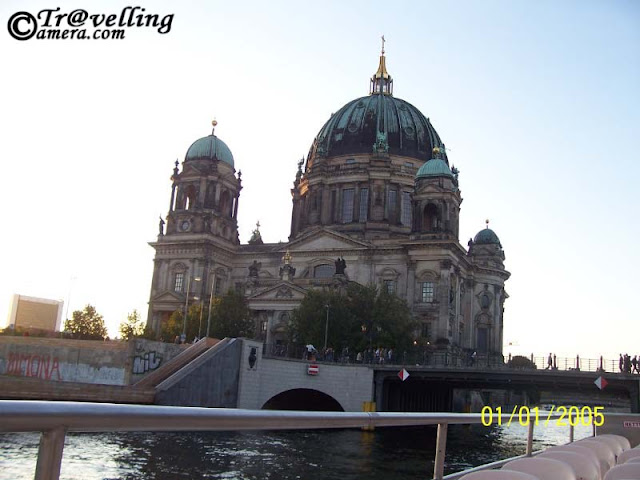 Free Trip to Spree River in Berlin, Germany by VIKAS SHARMA : Posted by VIKAS SHARMA at www.travellingcamera.com : The Spree is a river that flows through the Saxony, Brandenburg and Berlin states of Germany and in the Ústí and Labem region of the Czech Republic...It is a left bank tributary of the River Havel and is approximately 400 kilometres (250 miles) in length....Spree River flows through the city center of Berlin to join the River Havel at Spandau, a town in the western suburbs of Berlin...On its route through Berlin, the river passes Berlin Cathedral (Berliner Dom), the Reichstag and the Schloss Charlottenburg...The renowned Museum Island (Museumsinsel) with its collection of five major museums is actually an island in the Spree.The Badeschiff is a floating swimming pool moored in the Spree...Few days back I visited Germany for my official trip to Hannover.. During a weekend few of us planned to visit Berlin and we booked few seats in an excursion boat for a ride on Spree River... It costs 20 Euros for one person and I am going to share the views in free here... Have a look...The Supreme Parish and Collegiate Church in Berlin....We spent some time on shores of Spree river before getting the cruise ride in the river to explore Hannover... I loved the architecture of the city and there were many educational institutions & universities around...Another ship in Spree rivers... as we started journey through spree river, we saw different cruises on the way and all were different... but someone told me that the one we are in was among the popular once in Hannover... We were happy to hear that... but I don't remember what was the specialty because we were distracted with fun-filled travel in Spree....Here is another view of Catholic church in Berlin...Its sunset and colors around us started changing.. some of the building were looking amazing with sunset colors...All the colors in some directions started fading out with Sunset.. more towards black and white OR Sepi