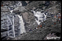 Waterfalls on the way to Mani Mahesh Lake : Posted by Vishal Sharma on www.travellingcamera.com : A long trek through Pir Panjal mountain range of Himalyas : PART-1 :  Himachal Pradesh is home to many historical and religious sites.... and also known as State of GODs... The state boasts of several exciting pilgrimage trails leading to sacred temples... The Manimahesh Yatra is one such pilgrimage which starts from Lakshmi Narayan Temple in Chamba and ends at the Manimahesh Lake  in Bundhil valley... Here are some PHOTOGRAPHS of Waterfalls on the way to Manimahesh : MANIMAHESH YATRA 2010There are countless number of waterfalls on the way and water in all of the streams in considered very medicinal... I met a gentleman who told that some medicinal plants of Himalayas are found in this region and water is very good for skin, breathing and other things which I forgot :)The Manimahesh Lake is believed to be one of the abode of Lord Shiva as per the Hindu mythologies... Notice pilgrims in colorful dresses in this photograph and try to think about the height of this waterfall... Last time I had such huge waterfalls on Shrikhand Trek ...The pilgrims walk along the rocky path completely bare footed, singing Bhajans and praying ecstatically to Lord Shiva... After reaching Mani-Mahesh Lake they take dips in the holy water. With the termination of the Manimahesh Yatra, the devotees visit the ancient temple of Chatrari, which is located between Bharmaur and Chamba...Some of us tried to climb up these hills on with these water streams but its near to impossible to complete with these streams...The wonderful route not only attract the pilgrims but also excites the adventure lovers and tourists...Freshness flowing through heavy rocks @ Manimahesh, Chamba, Himachal Pradesh, INDIAWalking to the way of the Manimahesh Lake is a wonderful experience... One will forget the pains of the tiresome journey watching the wonderful natural scenery and fresh environment around.... However one should be physically fit to endure this journey in an altitude of 4100 meters.... The Manimahesh Yatra in Himachal Pradesh is treated as a state level fair as per the declaration of the Himachal Pradesh State Government. The Himachal tourism department has undertaken various plans and programs to promote this wonderful event... Manimahesh is well approached from Pathankot through Chamba and Bharnaur... Pathankot is nearest railway station to approach this place...  Freshness flowing through heavy rocks @ Manimahesh, Chamba, Himachal Pradesh, INDIAWalking to the way of the Manimahesh Lake is a wonderful experience... One will forget the pains of the tiresome journey watching the wonderful natural scenery and fresh environment around.... However one should be physically fit to endure this journey in an altitude of 4100 meters....