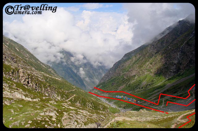 Typical Trekking routes on the way to Manimahesh Yatra in Himlayas (Pir Panjal Mountain ranges) : Part-1 : Posted by VJ Sharma @ www.travellingcamera.com : For last few day I have been sharing some of the photographs clicked during my Trekking experiences to Manimahesh in Chamba Distrcit of Himachal Pradesh... Today I thought of sharing some photographs of this trek and how these treks crwal on Himalayan Hills...So here are some pf the photographs showing typical trekking routes to Manimahesh...Its a wonderful trekking opportunity on Pir Pajal hills of Himalayas... As you can see in these photographs, these tracks look very small against the huge hills... and these are just the tips of the whole mountain range which is difficult to capture in one shot... Notice the small track on right bottom of this photograph and shaodws due to hill top... I am sure you would be able to imagine the height of this hill against sky and feel the mment when someone is moving on this trek... If you able to do so, expect some clouds coming on your way in few seconds :-)Here is same photograph with some marks around the main trekking path to Manimahesh... If you had some difficulties understanding the first photograph, now it should be easy to enter the virtual world of himalyan Treks :-)If you are able to imagine yourself on this route, I am sure you would be able to relate to this photograph... Now we have reached a height after different curved paths.... Here is a view of a valley with some plain area which is being used for taking rest in the rested tents there... First photograph was clicked between this point and the tent-area we are seeing here....Again some marks to help you better understand the route... route starts from left most mark.. breaks at right-top end of this photograph... and after a hidden route (covered in first photograph...) , path again move towards the left...Hold on... See this photograph and imagine yourself standing somewhere on this path... can you guess ho