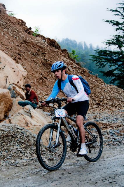 First Day rides during MTB Himachal 2010 - A Road journey in Himalayas : Posted by VJ SHARMA on www.travellingcamera.com : Hope you have already checked flag-off and some glimpses of MTB Himachal 2010... If not, I would recommend you to check out following two links before checking these photographs of very first day...Here are few more photographs of first day of MTB Himachal 2010 - Shimla  Mashobara Shainj (Final Destination for the day)MTB Riders climbing a normal height on good roads on first day...The flagoff from Shimla Ridge was a great improvement over previous year's start from the Peterhoff hotel grounds - more accessible to the general public and the first day's stages were a bit of a warm up... All the riders started from Ridge and moved towards Mashobara.. A few kilometers from Mashobara, first stretch for racing had to start... All set and it started in batches for 8-12 riders...Some of the MTB riders were very fast and they always lead the whole group... A Group from Nepal and another was Indian Army group... They had best cycles as compared to other folks..One of the rider coming towards the bike after taking rest.. It was raining, so some of us stopped riding and rested till it stopped... Notice the road conditions and imagine how they would have been after rains...As far as I remember, there were only two girls who were riding.. One was indian and other was from Nepal... Here is Number 57, Indian Rider who had great sense of humor :-)Another rider of the gang who faced lot of hurdles on the way... But he rode till the end...Every rider had a diary with him/her.. Before starting of any stretch, volunteers used to write down the time in those diaries and duration was calculated on ending of each stretch... Riders used to move in various groups and final timing had to be calculated on last day...Can you guess who are these?Here comes Mr.Rocky with his racing car... For now I am not explaining anything about it because I will have a separate post on this vehicle :-)It had been raining the day before and was still overcast ... After covering few kilometers, it started raining and since we were in Forests of Deodars, there was no place to hide from rains....Here comes Mr Suban Walia, who joined the gang mid-way... I think, he had just parked his Swift to take some photographs of riders on the way.... A true fan of NIKON We met many friends during this event and one of the Photographer called all the dogs with same name