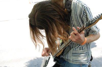 Alex tuning his guitar.