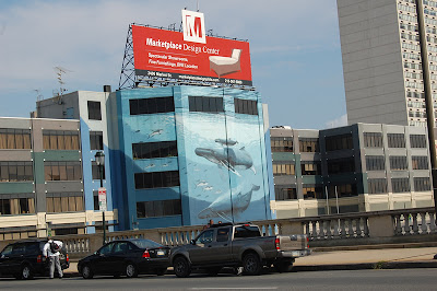 Whale mural on building.