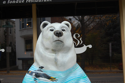 Sculpture of a bear in front of a restaurant.