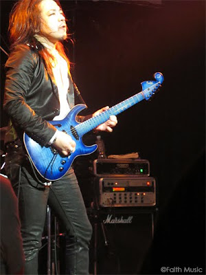 Kelly with his new guitar,   Virtuoso