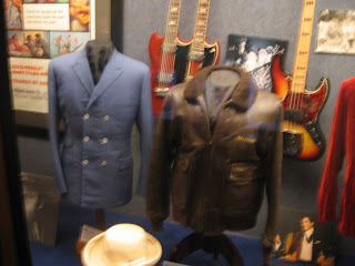 elvis uniforms and guitars