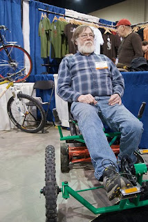 Ted Wojcik on the pedal powered lawn mower made for my brother Matt