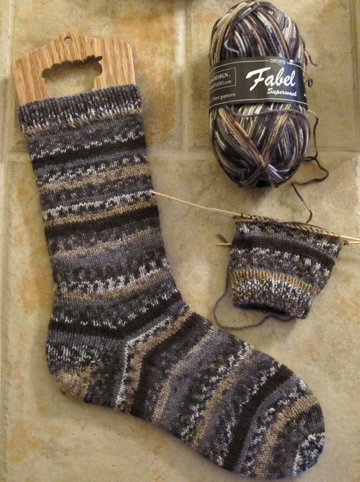 ive knitted with and liked garnstudios yarns but id never tried their sock yarn before i liked the color too a brown gray black mix