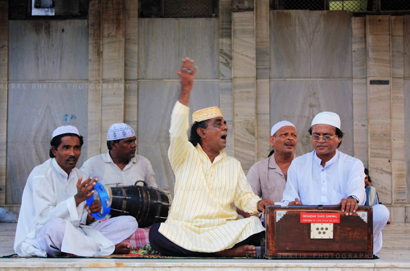 Qawali singers at the Haji Ali shrine in Mumbai by Kunal Bhatia. Islamic place of worship in Mumbai. Religion. Photograph.