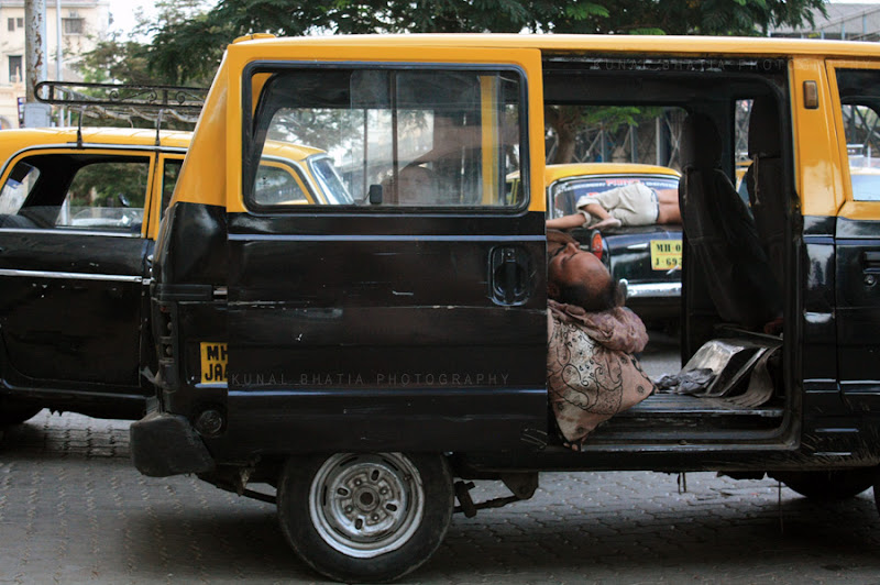 Cab drivers in Mumbai asleep in their cabs parked on the street. Photo blog from Mumbai by Kunal Bhatia