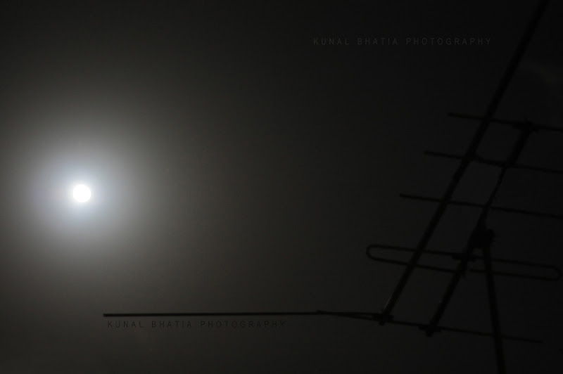 moon lit sky in mumbai by kunal bhatia with a canon 50mm prime lens