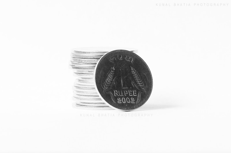 indian rupee symbol coins stacked up. stock photo by kunal bhatia