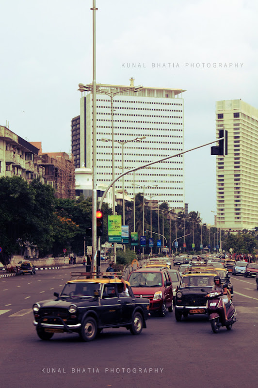 vehicles at a traffic junction on marine drive in south mumbai by kunal bhatia photo blog air india building