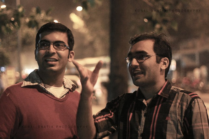school friends two male men boys looking pointing night street portrait in mumbai by kunal bhatia