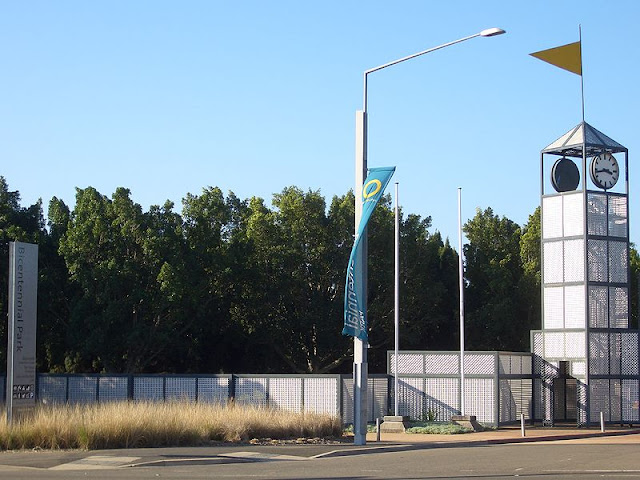 This Entrance To Bicentennial Park Is Along Australia Avenue In The Western Suburb Of Homebush Bay It Features A Lattice Clock Tower And Fence