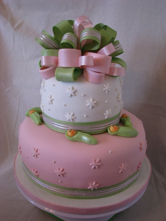 Baby shower for a little girl with sweet pea babies, gumpaste bow and ...