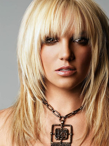 Britney Spears beautiful long straight hairstyle with cute bangs