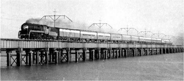 Train crossing bridge Mumbai aka Bombay