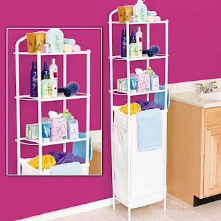 slim storage tower with hamper creates space in bathroom for