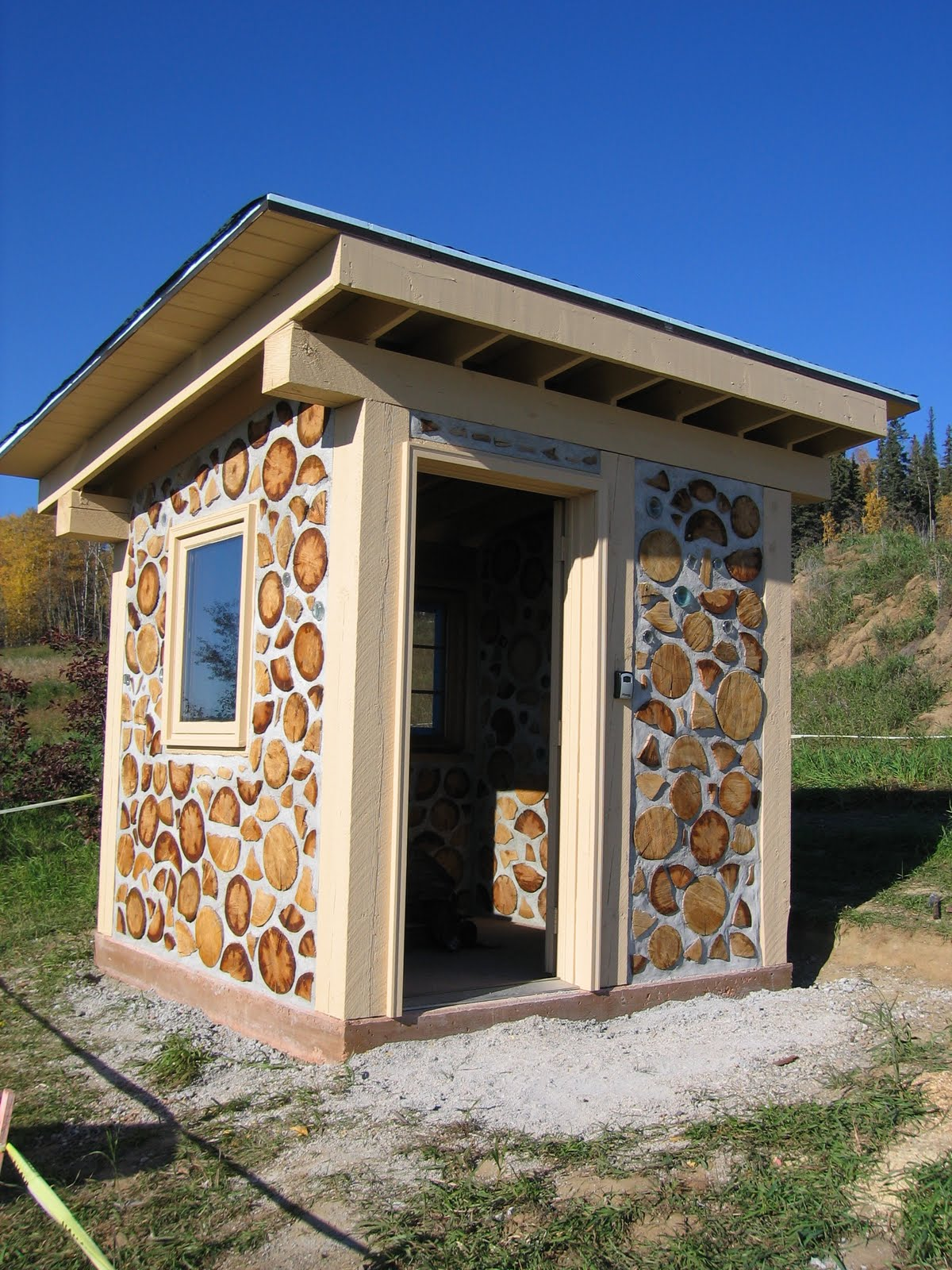 Cabin wood ideas cordwood homes outdoor cord wood for Cordwood shed