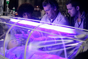Walter (John Noble, C) explains his findings to Astrid (Jasika Nicole, L) and Peter (Joshua Jackson, R) during an experiment in the FRINGE episode 'In Which We Meet Mr. Jones'