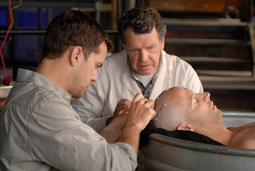 Peter (Joshua Jackson, L) and Walter (John Noble, C) tap into a dead man's memory in the FRINGE episode 'In Which We Meet Mr. Jones'