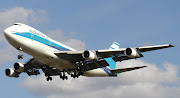 An El Al Cargo Boeing 747200 landing at London Heathrow Airport . (an el al cargo boeing landing at london heathrow airport )