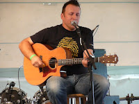 Paul Coleman playing guitar and singing under the Nashville tent at the Revelation Generation festival, 2009
