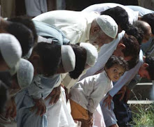 Pakistani Girl Watches Men Pray