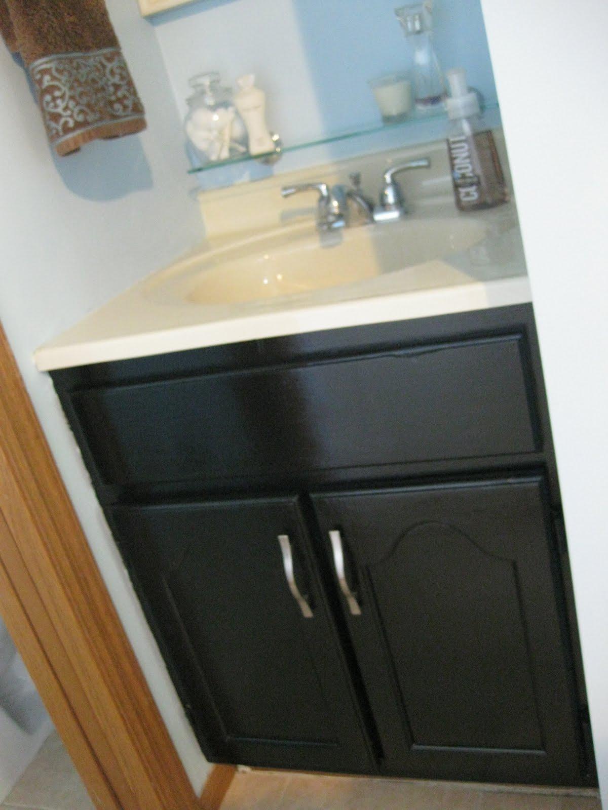 We also put up an ultra sleek looking glass shelf above our faucet: