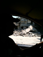 Mark Kirwin driving by disaster site