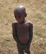Photo of a young boy without clothes taken during 2006 drought crises in Bihar, India.