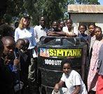 Angela Kirwin with Tanzanian Roots & Shoots youth.