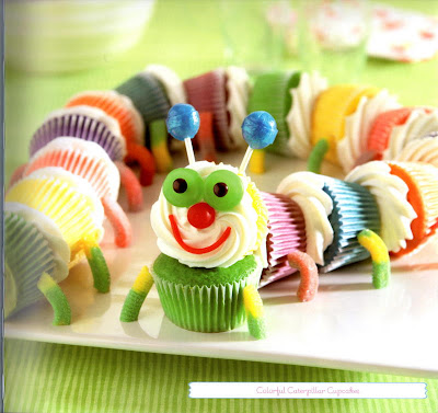 Rainbow colored cupcakes decorated to look like a catepillar