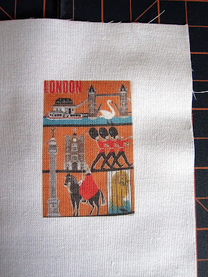 Piece of fabric with an image of a vintage tea towel printed on it.