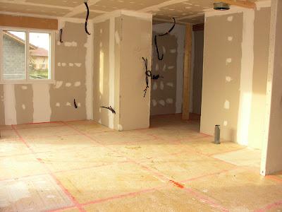 une maison ossature bois l 39 isolant de sol. Black Bedroom Furniture Sets. Home Design Ideas
