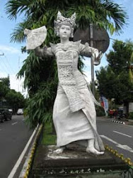 A Legong Dancer Statue Lines a Balinese Auto Expressway
