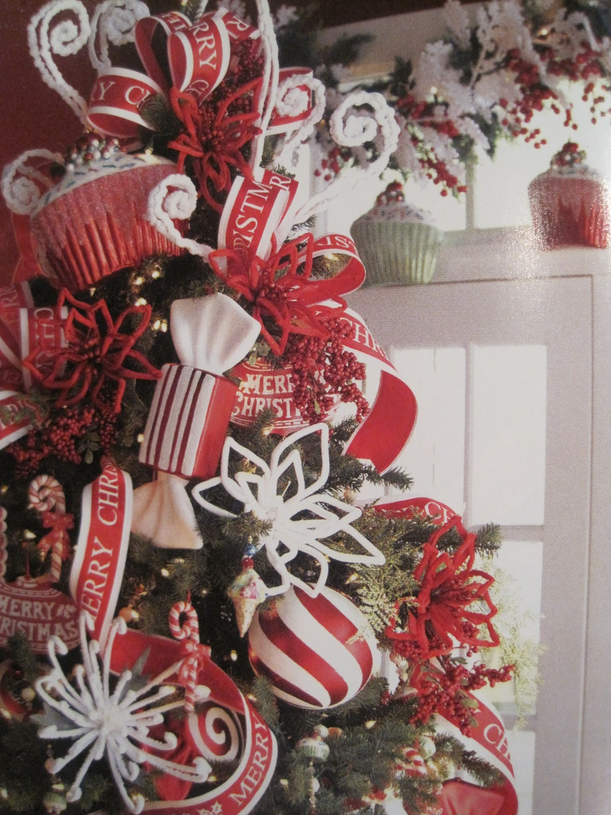 The tree topper which is not a topper at all its layers of ornaments and picks large ornaments add double the wow