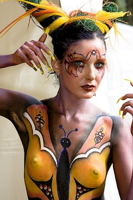 sexy girl body painting with women photo, butterfly, and dress form
