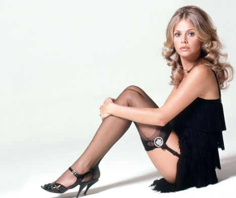 Britt Ekland is sexy '70s glam in a multi-tiered fringe dress