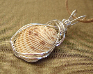 wire wrapped venus sea shell pendant