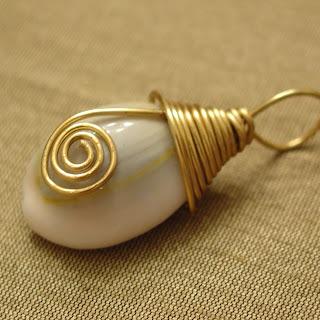 wire wrapped cowri sea shell pendant